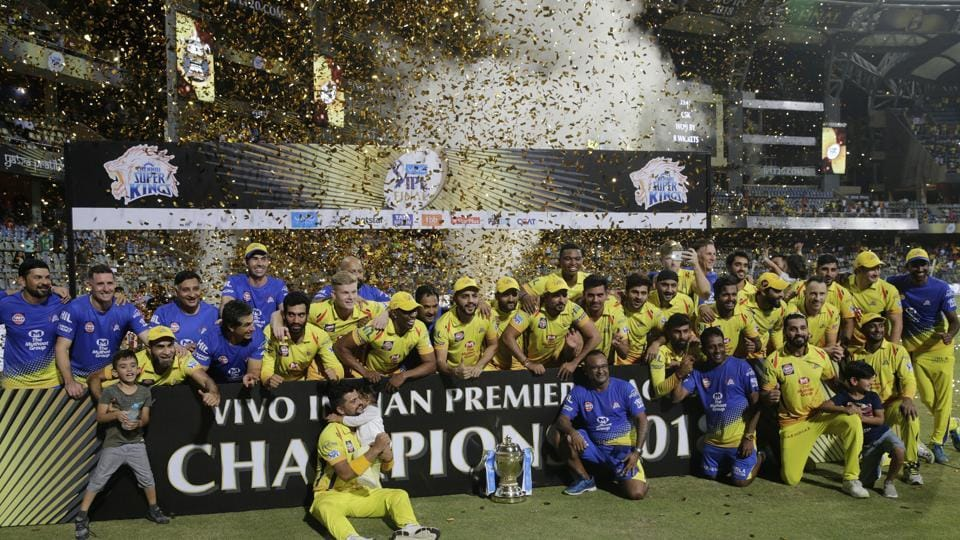 Members of Chennai Super Kings pose with trophy after wining against Sunrisers Hyderabad's at IPL cricket T20 final match.