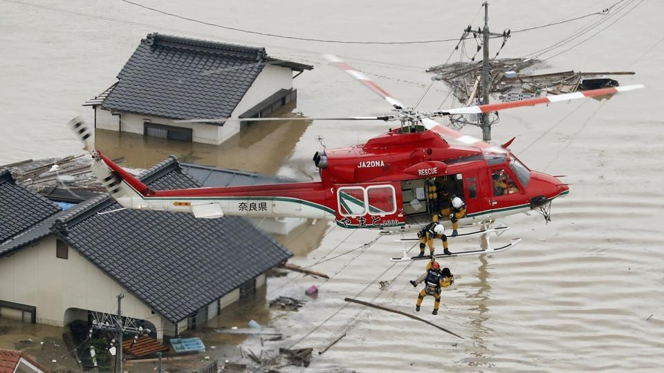 A local resident is rescued from a submerged house by a rescue helicopter in Kurashiki. The crisis is the deadliest rain-related disaster in over three decades, and one that has sparked national grief. On Monday Prime Minister Shinzo Abe cancelled a four-stop foreign trip as the death toll rose. (Kyodo via REUTERS)
