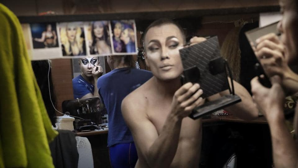 Sergey (L), who uses the stage name Bomba, and Andrei, who goes by Star Vasha apply make-up backstage at the Fame gay club in Yekaterinburg, Russia. In this modest dressing room, the men apply eye shadow with an expert touch, slide on fishnet stockings or thigh-high boots, then take to the stage with an uninhibited freedom they can only enjoy within the walls of this nightclub. (Vadim Ghirda / AP)