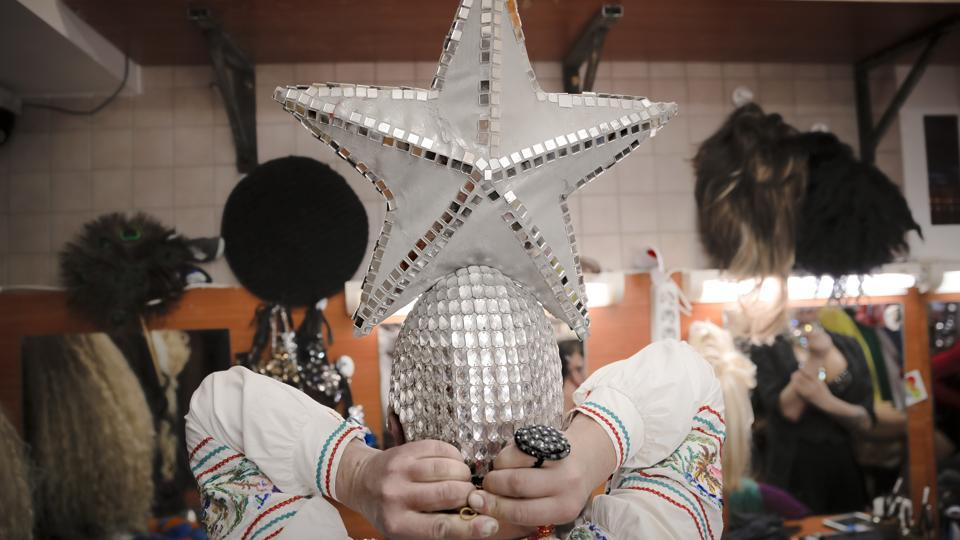 Bomba dons an embroidered Slavic-style blouse and headgear topped with a silver star, reminiscent of the stars perched on the towers of the Kremlin. When she performs a Russian traditional dance, the crowd goes wild. (Vadim Ghirda / AP)