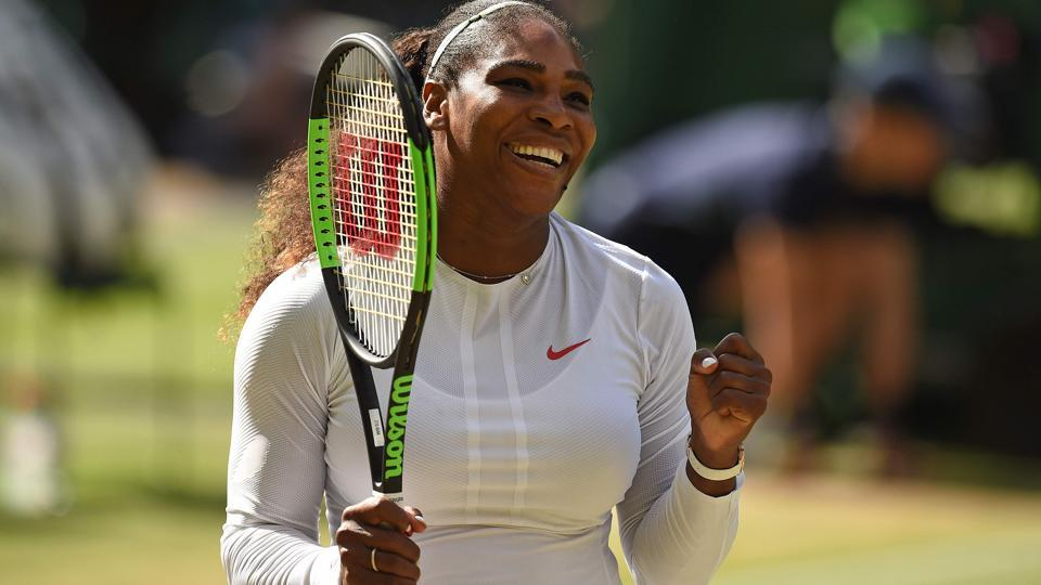 Serena Williams celebrates after winning against Camila Giorgi during their Wimbledon quarter-final encounter.