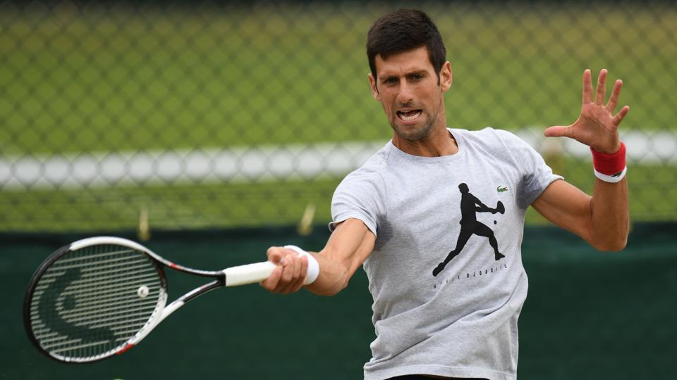 Serbia's Novak Djokovic practices at the All England Lawn Tennis Club in Wimbledon on Tuesday.