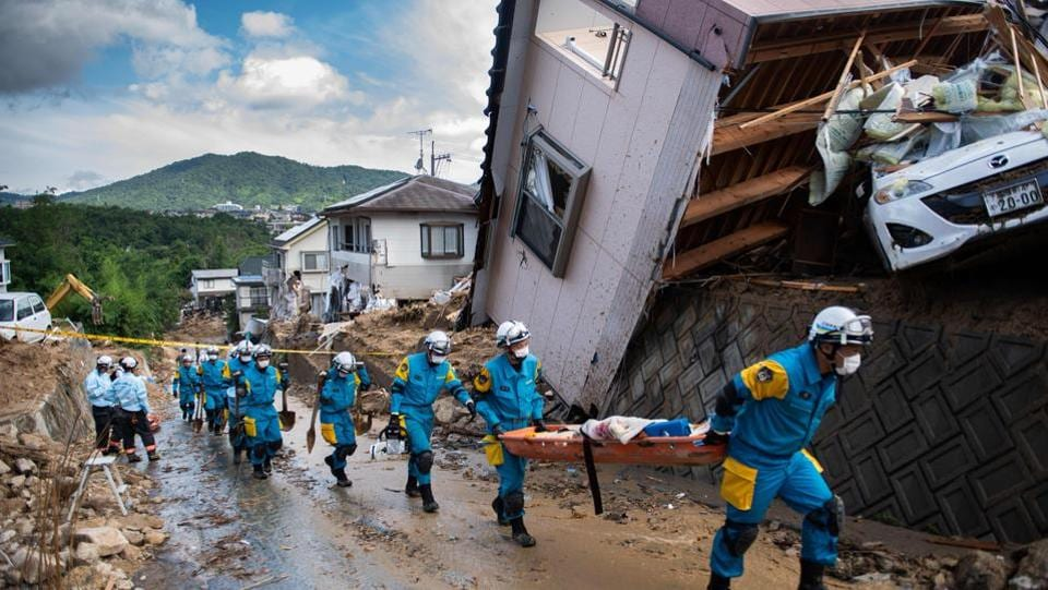 Some homes are totally smashed, while others are tilting precariously. The government has said it will tap around $20 million in reserve funds to provide aid to those affected by the disaster. PM Shinzo Abe is expected to visit the areas in coming days. (Martin Bureau / AFP)