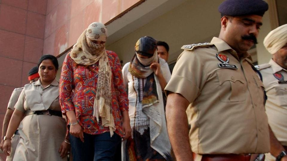 The two women being taken to a court in Mohali.