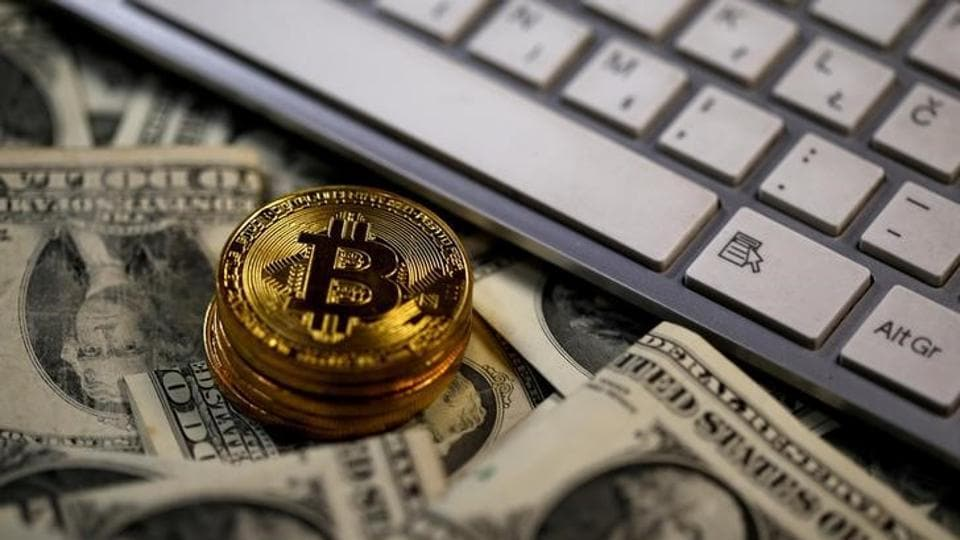 Bitcoin (virtual currency) coins placed on Dollar banknotes, next to computer keyboard, are seen in this illustration picture.