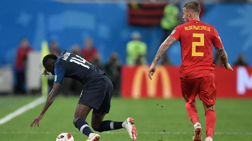 France's midfielder Blaise Matuidi (L) is fouled by Belgium's defender Toby Alderweireld.  (AFP)