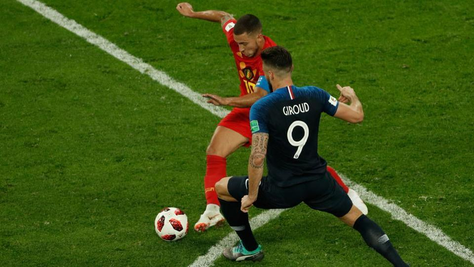 Belgium's forward Eden Hazard (rear C) vies for the ball with France's forward Olivier Giroud.  (AFP)