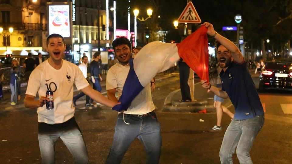 Tens of thousands of fans poured on to the Champs Elysees as bars, cafes and restaurants enjoyed a bumper evening of revelry. (AFP)