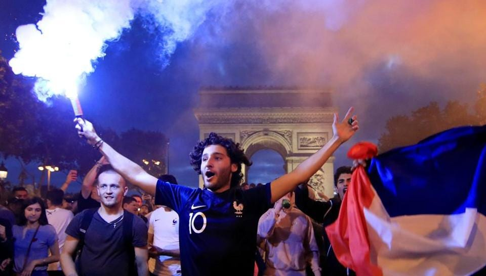 France fans react on the Champs-Elysees avenue after their team's win over Belgium in the FIFA World Cup 2018 quarterfinal. (REUTERS)