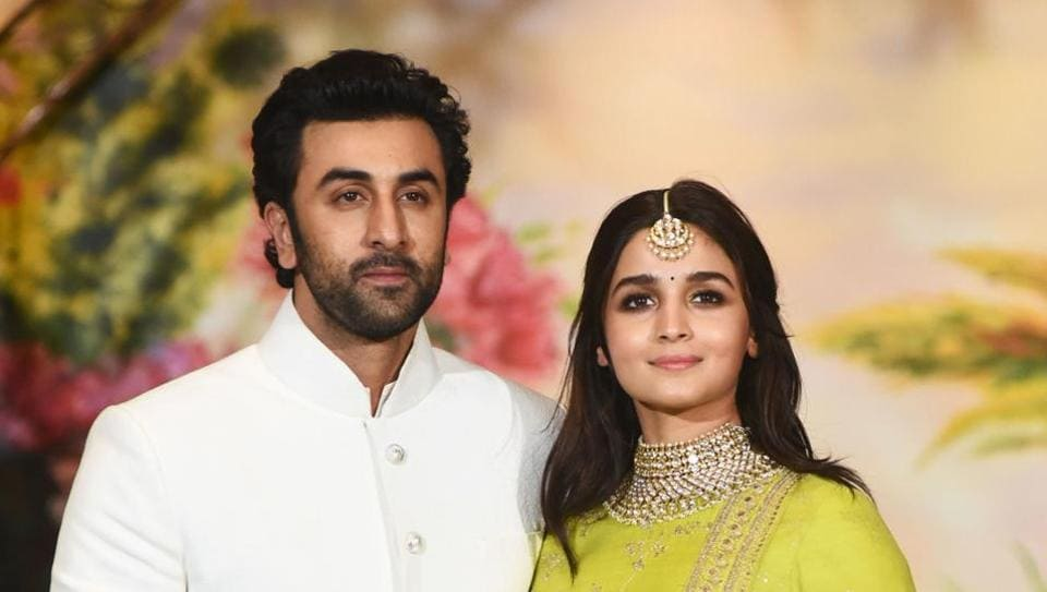 Ranbir Kapoor (L) and Alia Bhatt pose for a picture during the wedding reception of Sonam Kapoor and businessman Anand Ahuja in Mumbai.