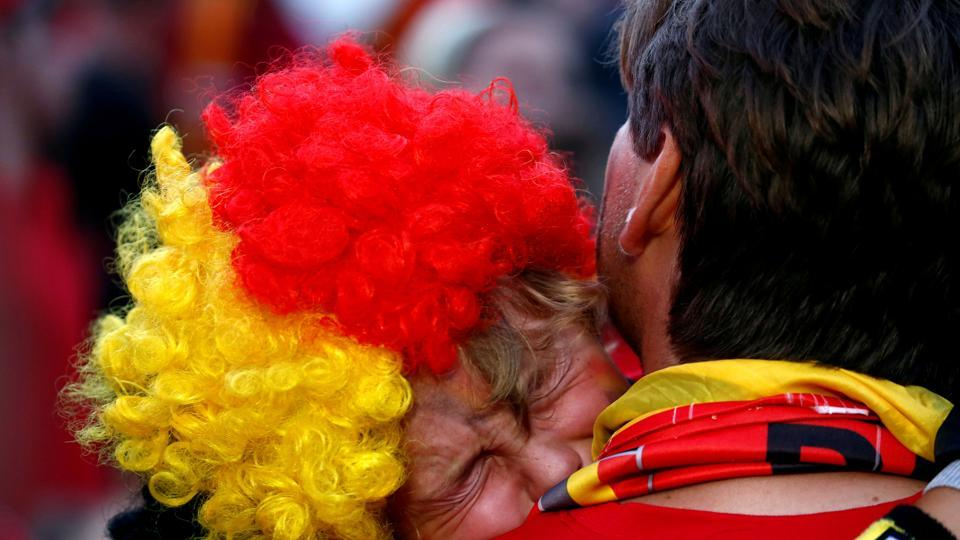 Belgium fan reacts after the match in the fan zone in Brussels. (REUTERS)