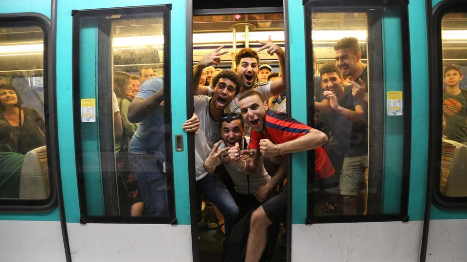 People celebrate France's 1-0 victory on board the metro in Paris. (AFP)