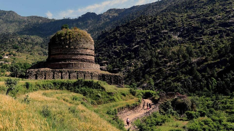 A centuries-old stupa, in the town of Amluk Dara near Mingora, the capital of the Swat Valley. The Italian government has been helping to preserve archaeological sites, working with local authorities who hope to turn it into a place of pilgrimage once more. A decade ago, militants climbed the six-metre effigy to lay the explosives, but only part of them were triggered, demolishing the top of the Buddha's face. (Abdul Majeed / AFP)
