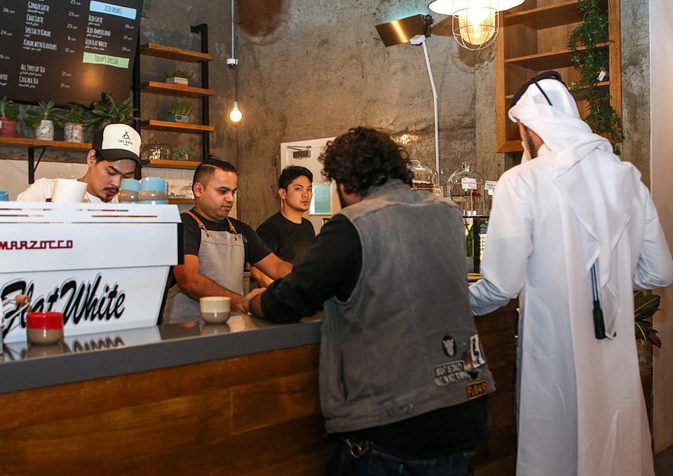 Customers queue for their orders at the Flat White cafe in the Qatari capital Doha's Tawar Mall.