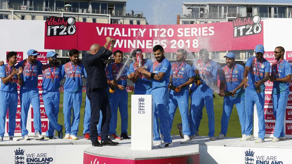 Champagne is sprayed as Indian players celebrate with the series trophy after the third international Twenty20 cricket match against England at The Brightside Ground, Bristol on July 8, 2018. (AFP)