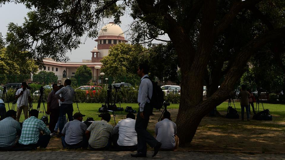 "The Supreme Court on Friday took a strong note of the Information and Broadcasting Ministry's decision to set up a social media hub for monitoring online data, observing that it will be ""like creating a surveillance state."" The top court said the government wants to tap citizens' WhatsApp messages and sought its response within two weeks. (Sajjad Hussain / AFP)"