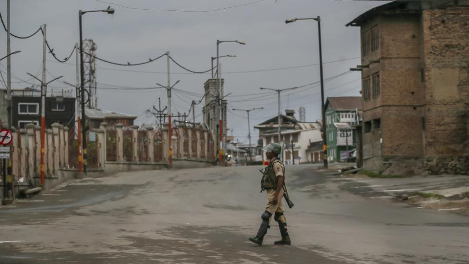 An Indian paramilitary soldier walks on a deserted road during curfew in Srinagar. Two CRPF jawans were killed and one injured in a militant attack in Jammu and Kashmir's Anantnag district on Friday, official sources said. The area has been cordoned off and a hunt launched to track down the assailants. (Dar Yasin / AP)