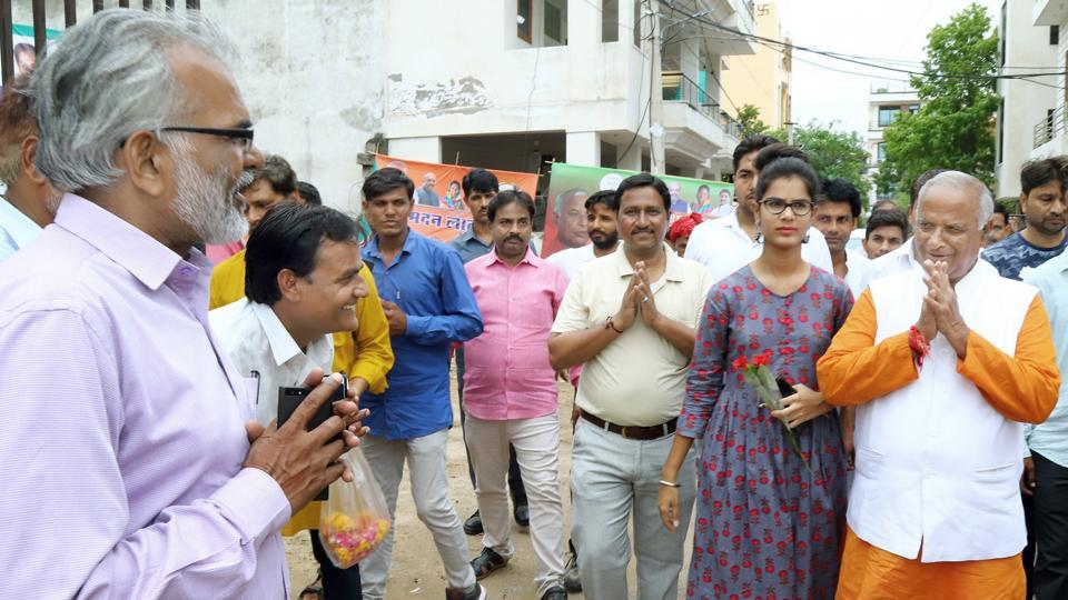 Supporters celebrate state BJP president Madan Lal Saini's birthday at his residence in Jaipur on Friday.