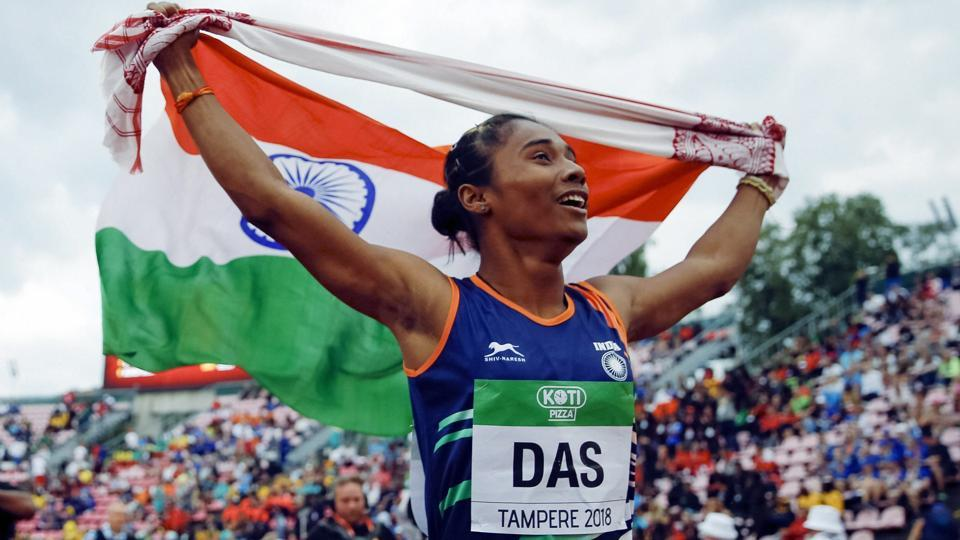 Hima Das celebrates her victory in women's 400 meter race at the 2018 IAAF World U20 Championships in Tampere, Finland.