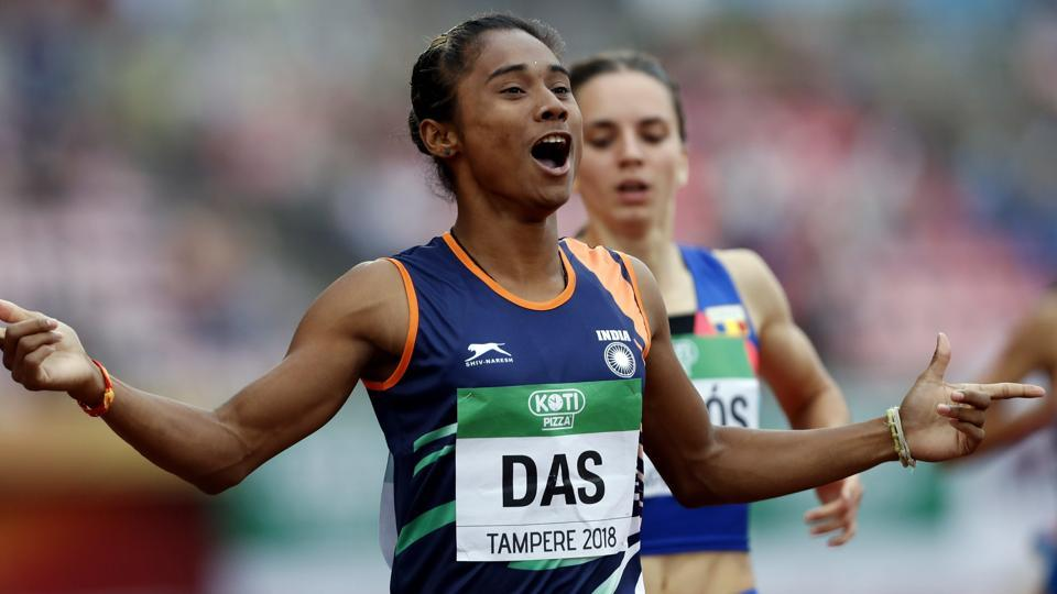 Hima Das celebrates her victory in women's 400 metre race at the 2018 IAAF World U20 Championships in Tampere, Finland
