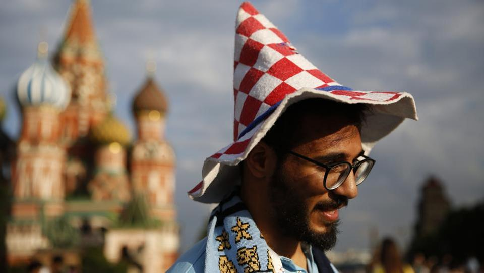 A man from Palestine wears a hat showing his support for Croatia as he visits the Red Square during the FIFA World Cup in Moscow. (AP)
