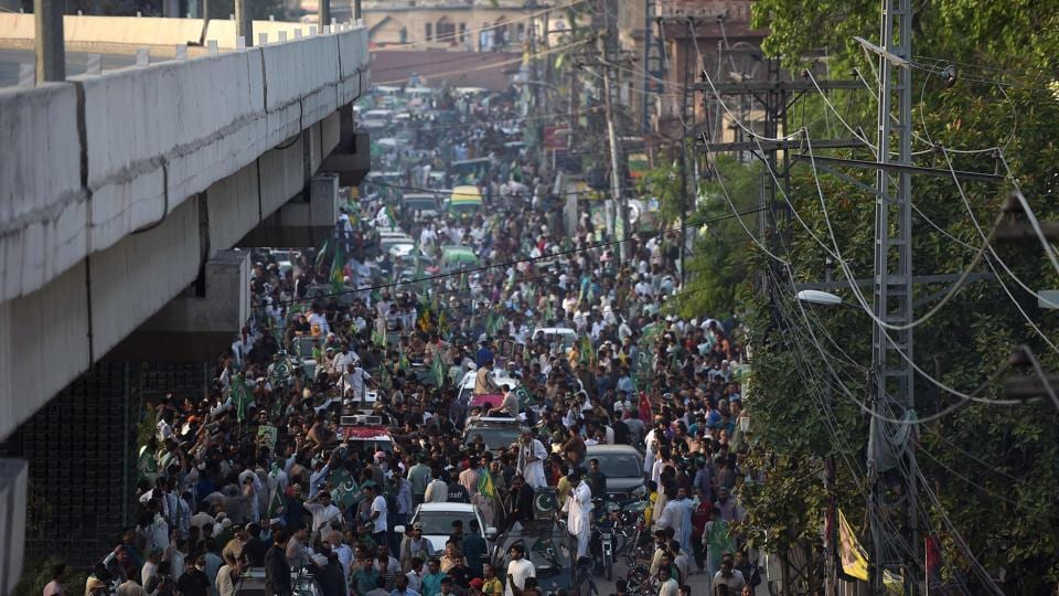Supporters of ousted Pakistani prime minister Nawaz Sharif take part in a march towards the airport ahead of the arrival of Nawaz from London, in rally led by Shahbaz Sharif, Nawaz's younger brother and the head of Pakistan Muslim League-Nawaz (PML-L) party, in Lahore on July 13, 2018.