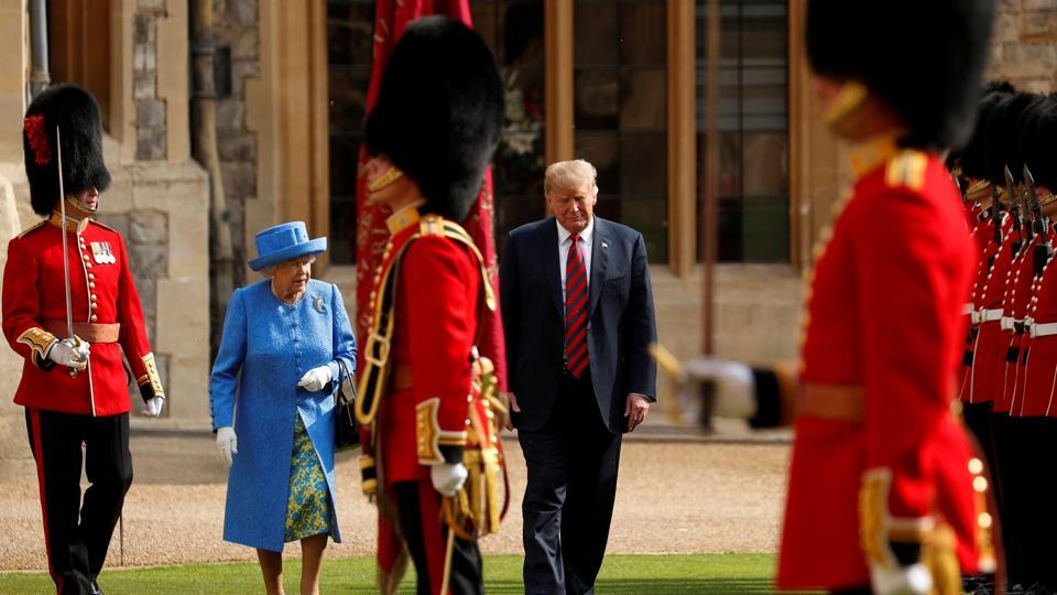 US president Donald Trump and Britain's Queen Elizabeth inspect the Coldstream Guards during a visit to Windsor Castle in Windsor, Britain, on July 13, 2018.