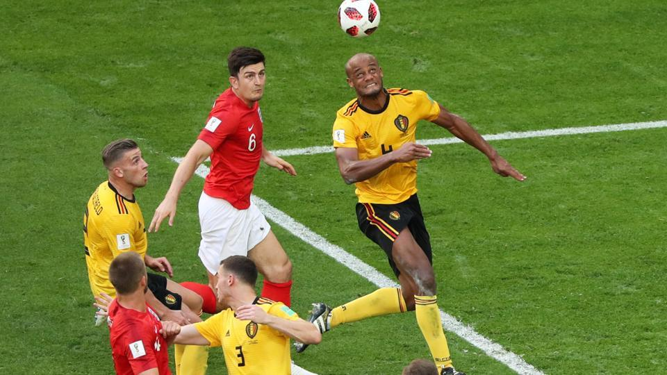 England's Harry Maguire in action with Belgium's Vincent Kompany. (REUTERS)