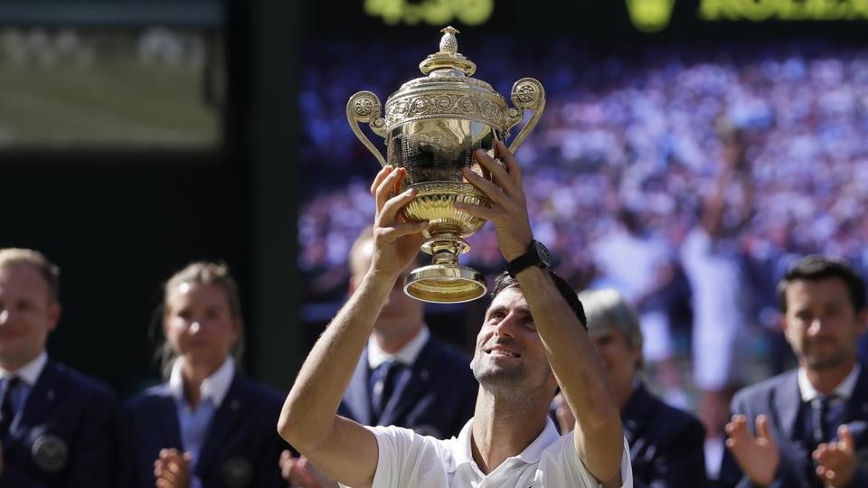 Novak Djokovic claimed his 13th Grand Slam and fourth Wimbledon crown with victory over Kevin Anderson in a largely one-sided men's singles final at the All England Club. (AP)