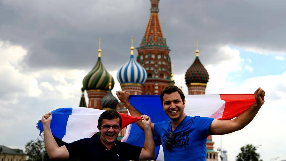 French fans pose on Red Square in Moscow on July 13, 2018, two days before the FIFA World Cup 2018 final between France and Croatia.