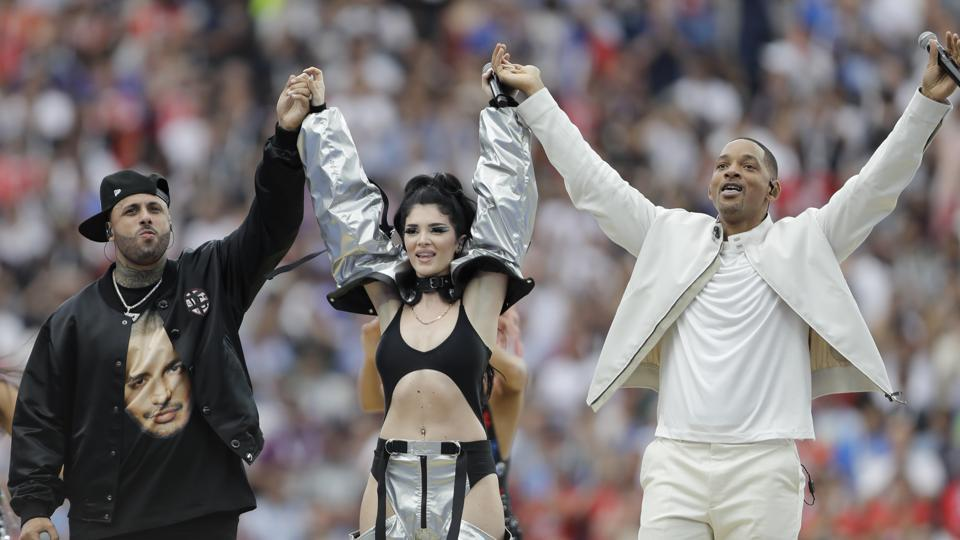 Singers Nicky Jam, left, Will Smith, center, and Era Istrefi perform during the closing ceremony prior to the final match between France and Croatia at the 2018 football World Cup in the Luzhniki Stadium in Moscow. (AP)