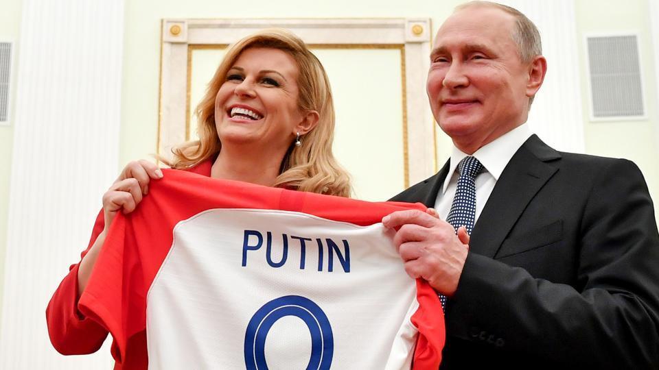 99718fe31 Croatian President Kolinda Grabar-Kitarovic (L) offers to Russian President  Vladimir Putin a jersey of the Croatian national football team bearing the  name ...