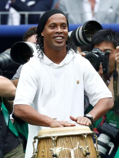 Former footballer Ronaldinho during the closing ceremony before the match. (REUTERS)
