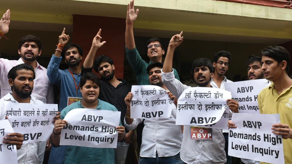 Akhil Bharatiya Vidyarthi Parishad (ABVP) activists and students of law raise slogans as they protest against LLM paper leak and LLB entrance exam, outside Dean's office at Delhi University. (Sonu Mehta / HT Photo)