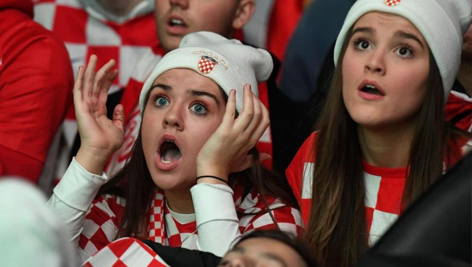 A Croatian fan reacts as France scores a goal while they watch the World Cup final in Melbourne. (AFP)