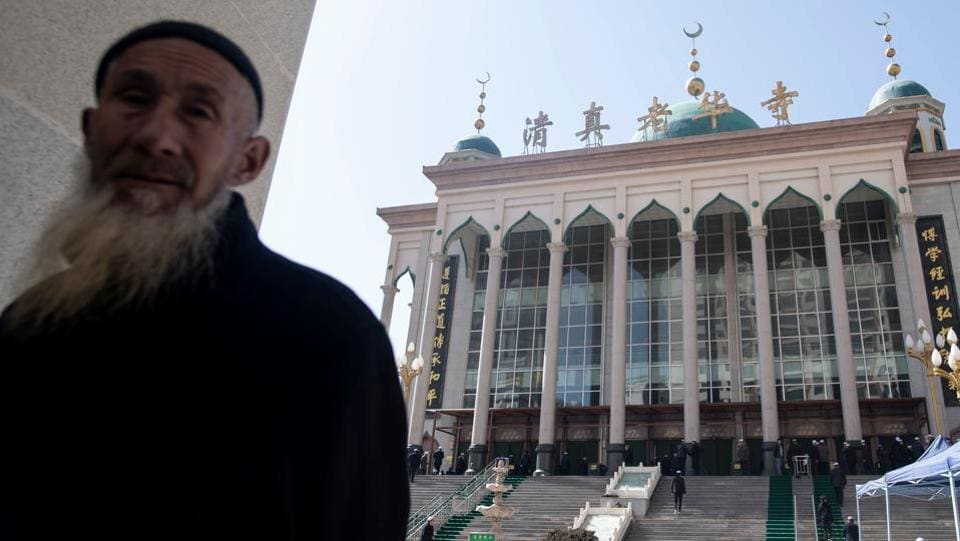 "China governs Xinjiang, another majority Muslim region in its far west, with an iron fist to weed out what it calls ""religious extremism"" and ""separatism"" in the wake of deadly unrest, throwing ethnic Uighurs into shadowy re-education camps without due process for minor infractions such as owning a Quran or even growing a beard. Now, Hui Muslims fear similar surveillance and repression. (Johannes Eisele / AFP)"