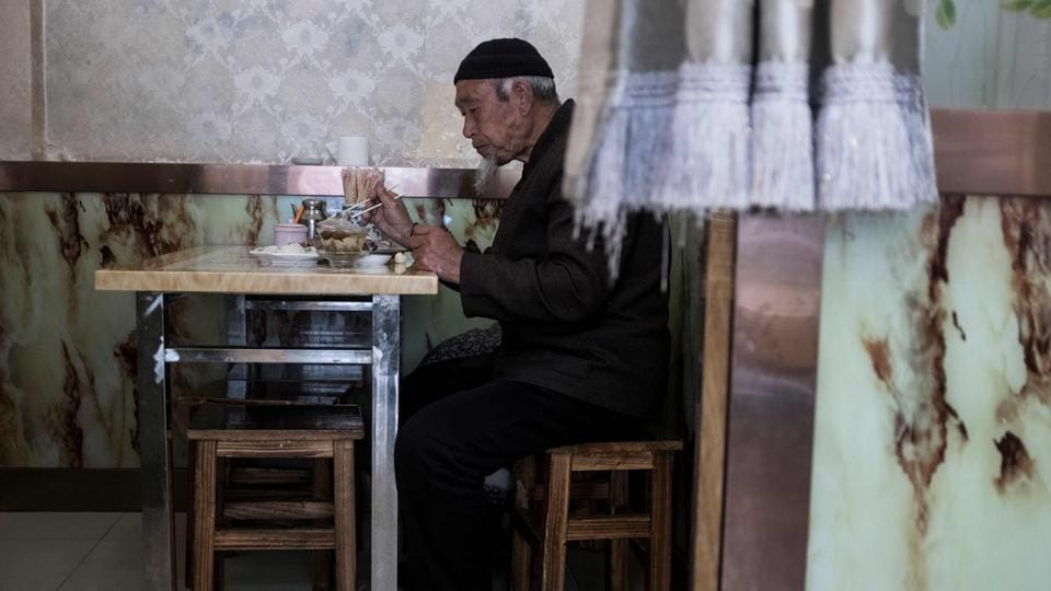 The Hui number nearly 10 million, half of the country's Muslim population, according to 2012 government statistics. In Linxia, they have historically been well integrated with the ethnic Han majority, able to openly express their devotion and centre their lives around their faith. (Johannes Eisele / AFP)