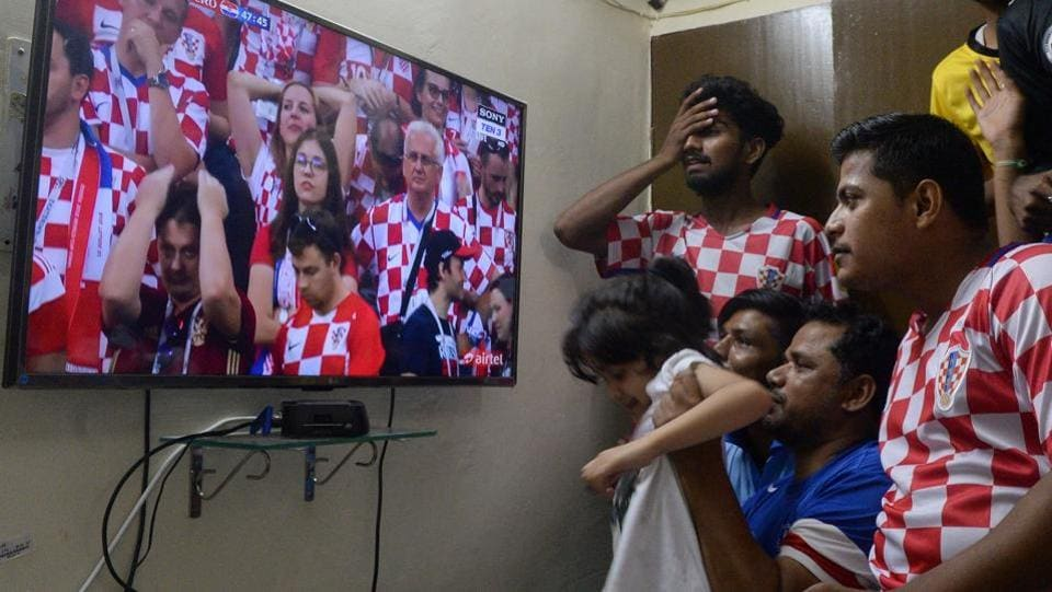 Indian football fans of Croatia react as they watch the Russia 2018 World Cup final match between France and Croatia in Allahabad. (AFP)