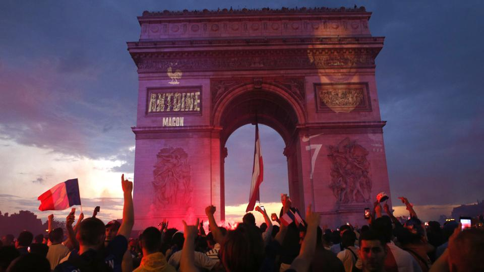 In Paris, where 90,000 people watched the match on vast TV screens next to the Eiffel tower, there were choruses of the Marseillaise, honking horns and hundreds of thousands of red, white and blue tricolor flags fluttering on the breeze. (AP)