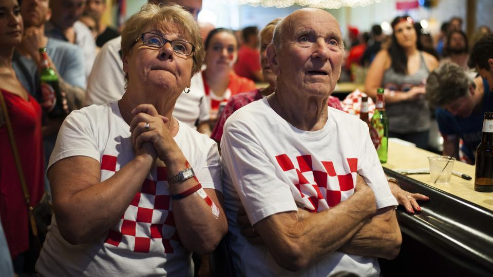 Croatia fans Joyce Simunovic, left, and her husband, Nikola Simunovic, right, watch the television in the last minutes of the World Cup match. (AP)