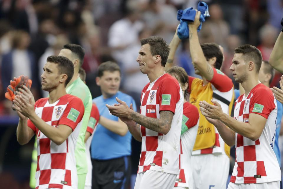 From left to right - Croatia's Josip Pivaric, Mario Mandzukic and Marko Pjaca applaud after losing the final. (AP)