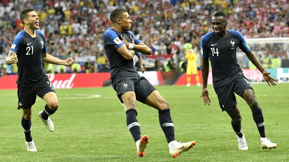 France's Kylian Mbappe, center, celebrates after scoring his side's fourth goal. (AP)