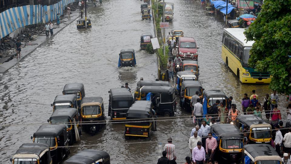 A view of a waterlogged street after heavy rain at Station Road, Nallasopara in Maharashtra. As Vasai, Virar and Nallasopara areas saw days of flooding after heavy rainfall last week, urban planners pointed fingers at poor planning coupled with ignoring geographical and environmental factors. (Satyabrata Tripathy / HT Photo)