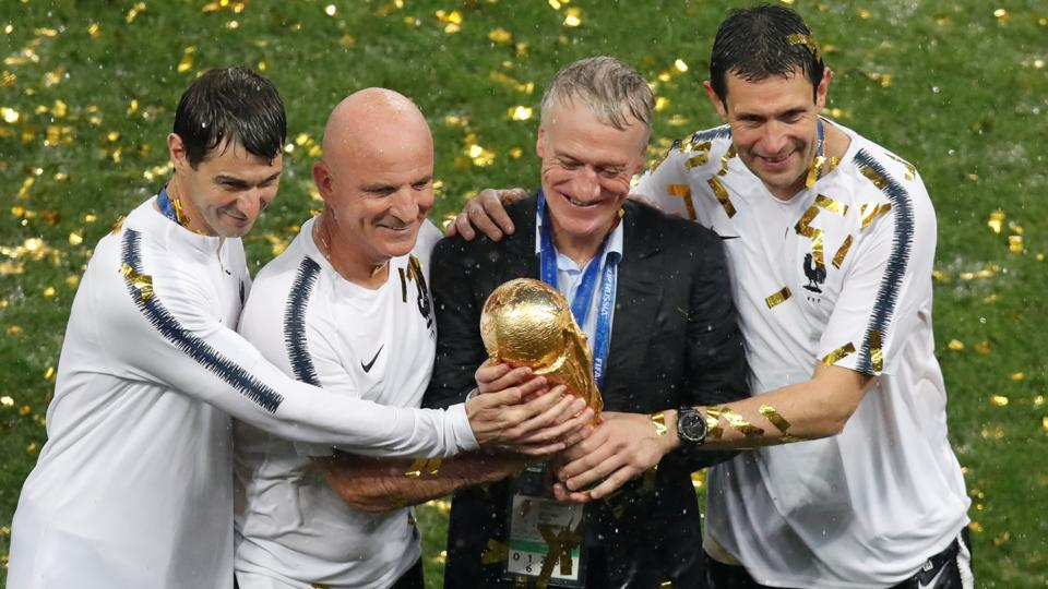 France coach Didier Deschamps with trophy as they celebrate winning the World Cup . (REUTERS)