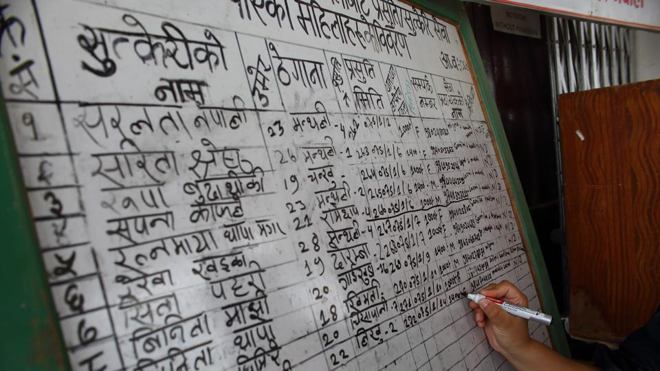 "A health worker lists a new mother on a board at a health centre. Nepal reduced maternal mortality by 71% between 1990 and 2015 -- missing out on an ambitious Millennium Development Goal to reduce the rate by three-quarters. But it has a long way to go in improving the overall quality of its healthcare, said Binjwala Shrestha, from the Safe Motherhood Network Federation of Nepal. ""Reaching the hospital alone is not enough,"" she said. (Bikram Rai / AFP)"