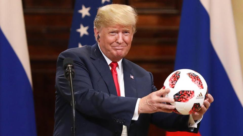 US President Donald Trump, receives a soccer ball from Vladimir Putin, Russia's president, during a news conference in Helsinki, Finland. Trumpcalled Special CounselRobert Mueller's probe into Russian election meddling a