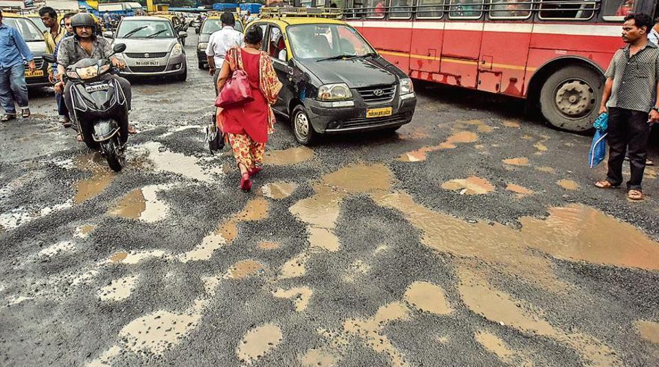 Image result for mumbai potholes