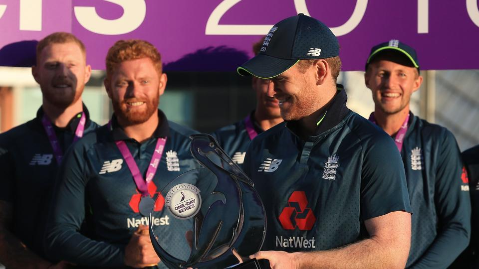 England's captain Eoin Morgan (C) holds the series trophy after the third One Day International (ODI) cricket match between England and India. (AFP)