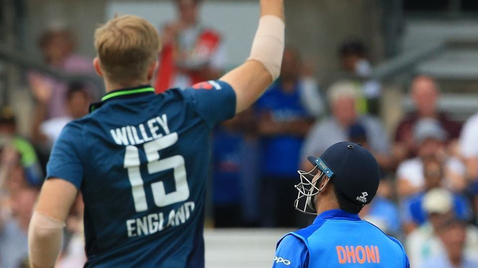 England's David Willey celebrates after England's Jos Buttler took the wicket of India's MS Dhoni. (AFP)