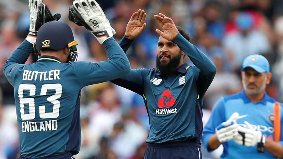 England's Adil Rashid celebrates taking the wicket of India's Virat Kohli. (Action Images via Reuters)